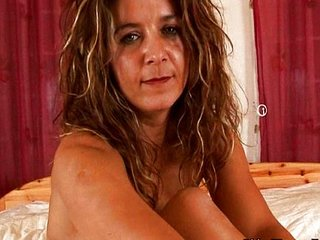 Horny mature wife plays with long dildo