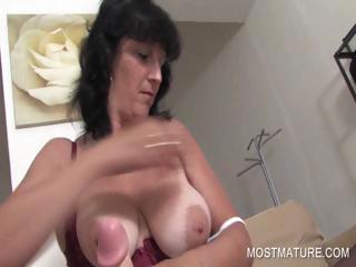 Mature playing with big dildo