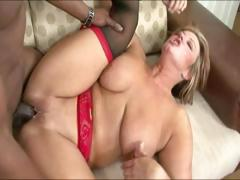 Horny milf with tattoo having interracial sex
