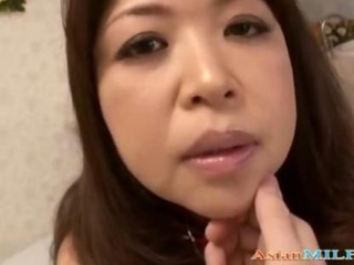 Cute Asian mature sucks on a guys dick