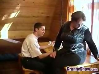 Chubby granny interrupts a young lads study