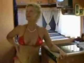 Mature blonde in red bikini