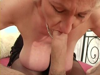 Cumshot on big mature tits